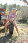 Country girl Rachel McDonald strips naked with her tractor