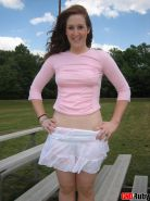 Super cute redhead teen Ruby teases on the park bleachers showing off her tight white panties