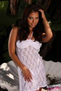 Pics of Cali Logan slipping out of her white lace