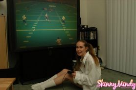 Pictures of Skinny Mindy enjoying a football game
