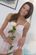 Beautiful teen Britney offers you her pretty flower