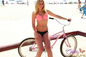 Ashley Vallone takes a moment to show off her hot body on her bicycle