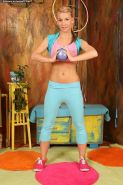 Fit gorgeous blond teen Rhonda gets naked after her yoga workout
