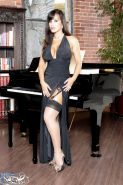 Pictures of Lisa Ann getting horny by the piano