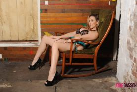 Busty beauty Jodie Gasson strips for you in a wood cabin