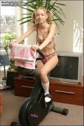 Blond teen in pigtails flashes while exercising