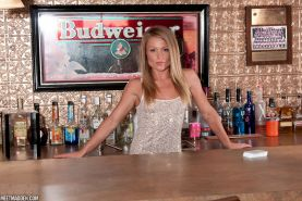 Blonde babe Meet Madden strips for you behind the bar