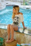 Pictures of teen cutie Kelly Brooke toying her pussy by the pool