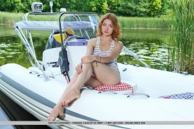 """Pretty redhead Kika spreads her legs for you on a boat in """"Niales"""""""
