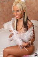 Pictures of a busty blond teen getting herself all wet