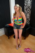 Pictures of teen model Emily's Dream teasing with a giant lollipop