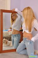 Pictures of teen Sandy Summers checking herself out in a mirror