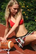 Pictures of GBD Jean playing football in a plaid skirt