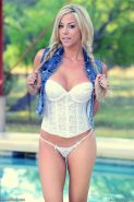 xoGisele looks hot in pigtails as she strips down her white corset and panties and touches her perfect body