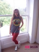Jodie Gasson strips from her rock and roll shirt and tight red pants