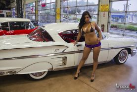 Busty hottie Briana Lee gets naked in a classic car